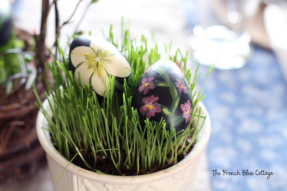 Grass grown from seeds in a ceramic pot for the Easter table.