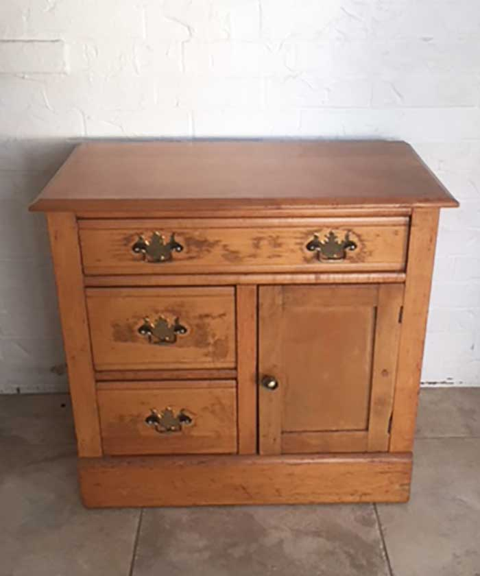 A vintage washstand in need of a makeover.