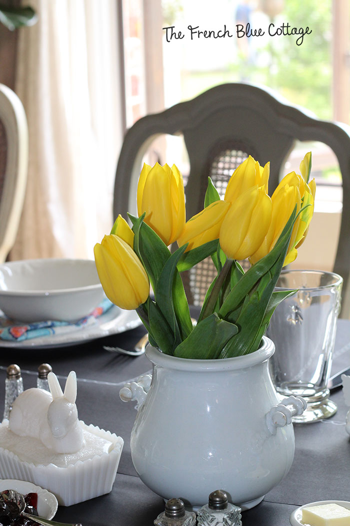 Yellow tulips in ironstone and a milk glass bunny make an easy Easter centerpiece.