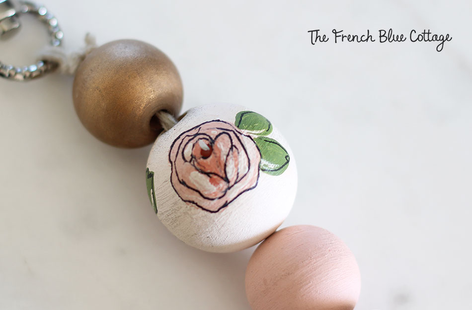Hand painted rose on a wood bead for a DIY keychain.
