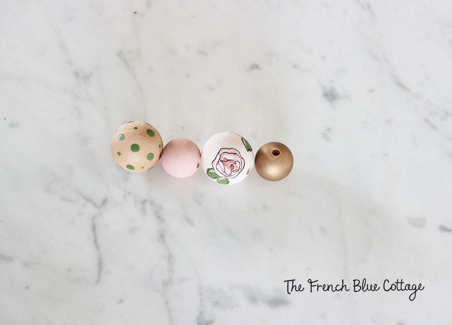 Painted wood beads for a diy tassel keychain.