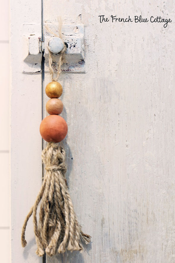twine and bead tassel hanging from bathroom cabinet
