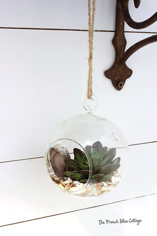 hanging terrarium with agate slice and succulent