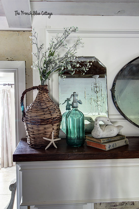 coastal inspired mantel with a basket jar