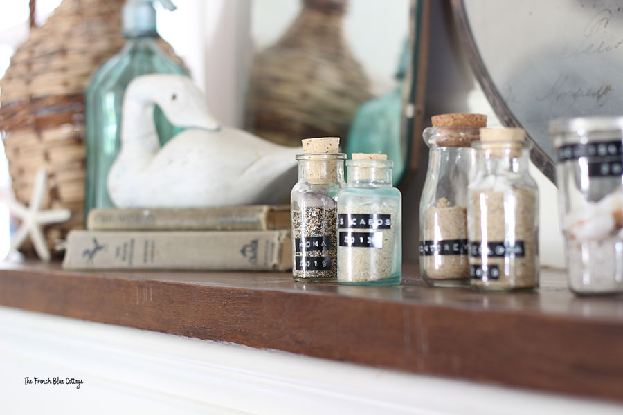 coastal inspired mantel with jars of sand