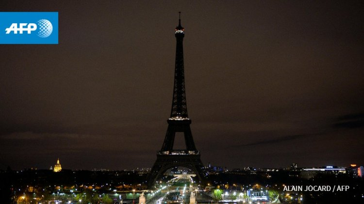 Agence France-Presse: November 13, 2015 - PARIS - The Eiffel Tower with its lights turned off following the deadly Paris attacks.