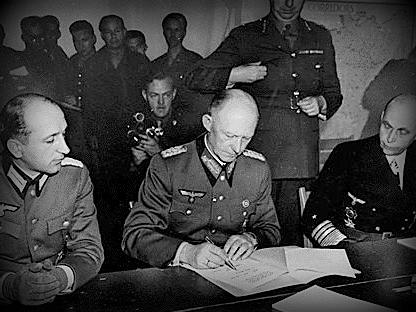 German Marshal Alfred Jodl signing the surrender of German armies in Reims on the 7th May 1945 - Victory in Europe Day