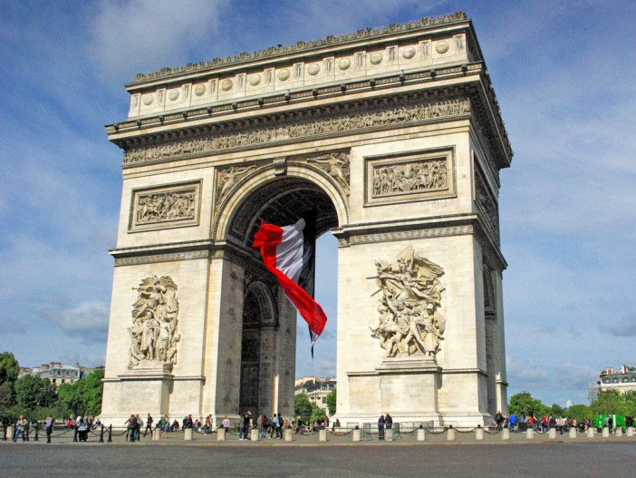 Arc de Triomphe and giant French flag © French Moments