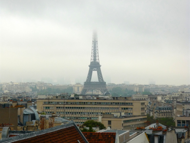 Eiffel tower with its top in the clouds © French Moments