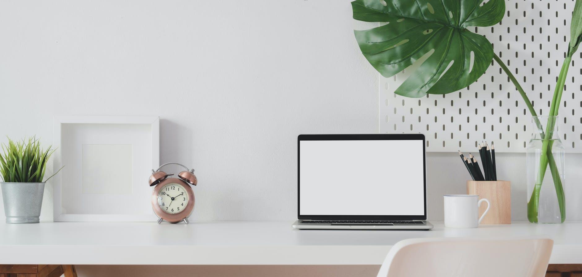 photo of laptop on white table