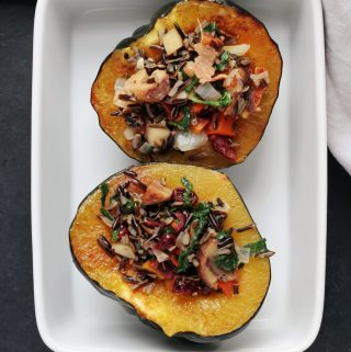 wild rice, kale, chestnut and cranberry stuffed acorn squash