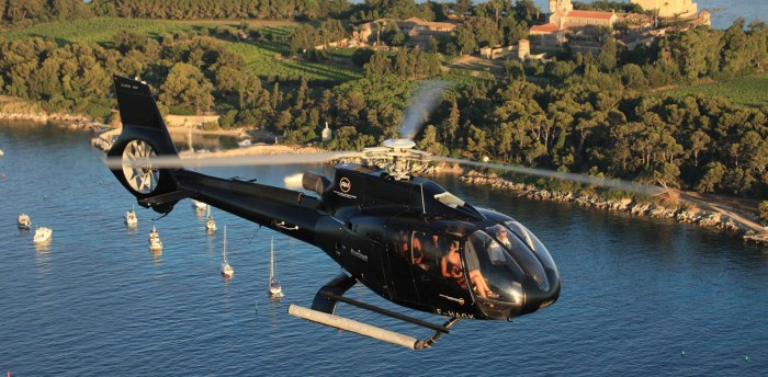 Helicopter flying over the islands off Cannes, France