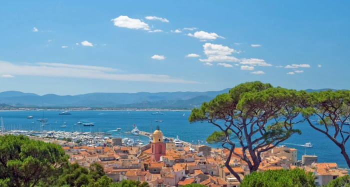 View over St Tropez rooftops and superyachts in the bay of Saint-Tropez.