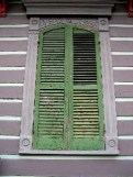 Shuttered Windows: This architectural photograph was taken a few steps from the stoop photo. It presents simply a window with the shutters closed, with subtle greys and greens. The patina on this shutter made me want to rip it off the building, take it home and hang it on the wall. Architectural fragments are an artform that I have always loved.