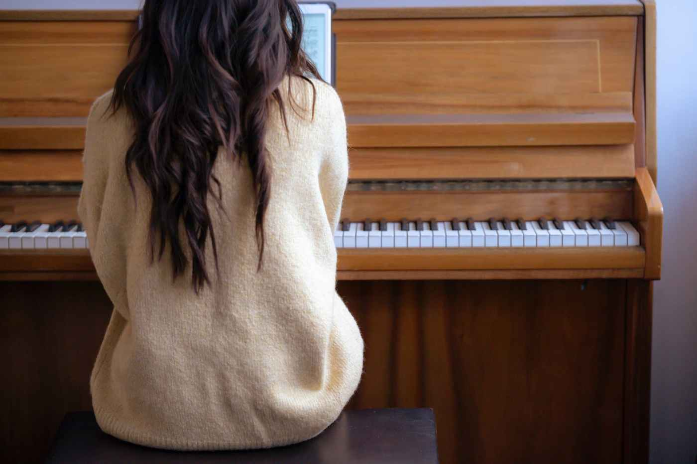 woman playing piano at free time