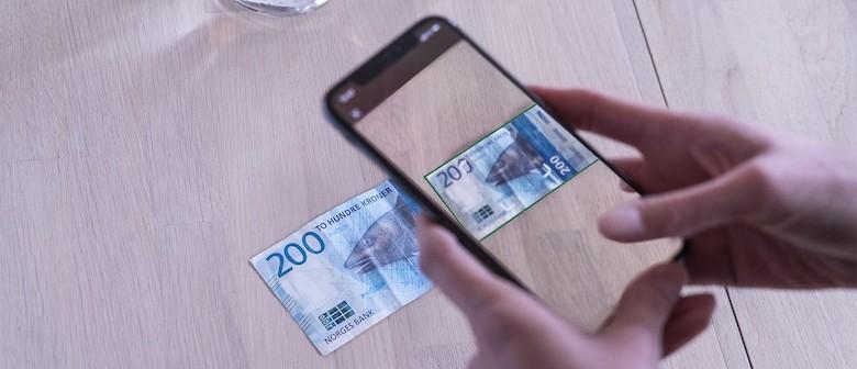 lokal valuta eller norske kroner