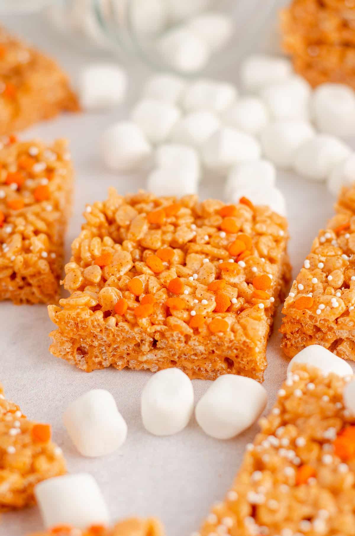 pumpkin rice krispies treats surrounded by mini-marshmallows