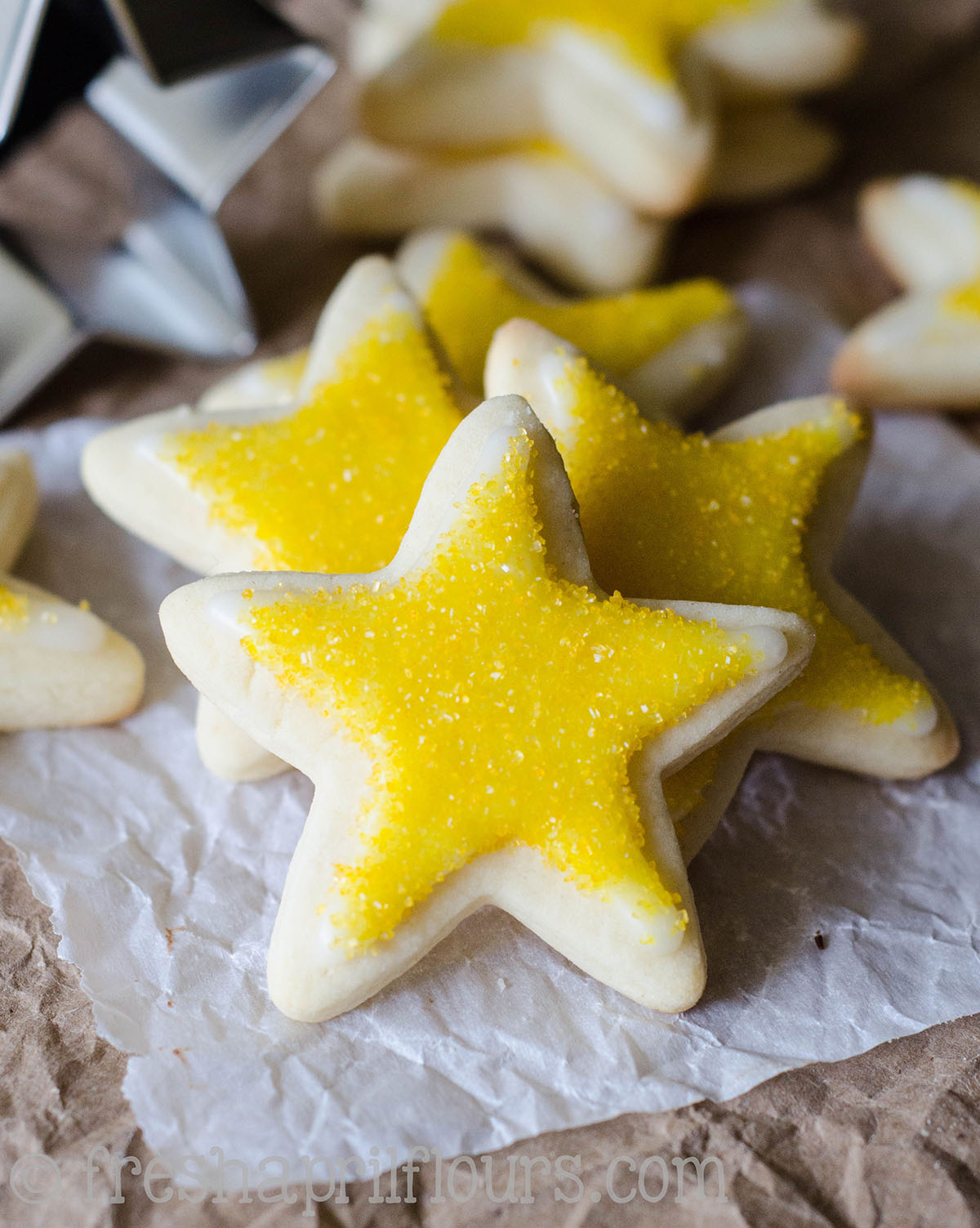 star shaped cut-out sugar cookie with yellow sanding sugar