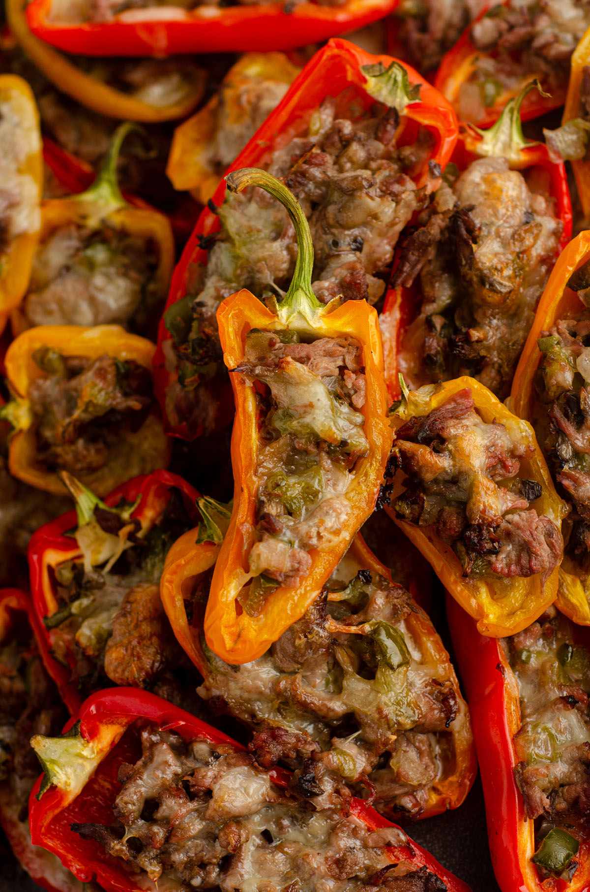 mini philly cheesesteak stuffed peppers in a pile on a plate