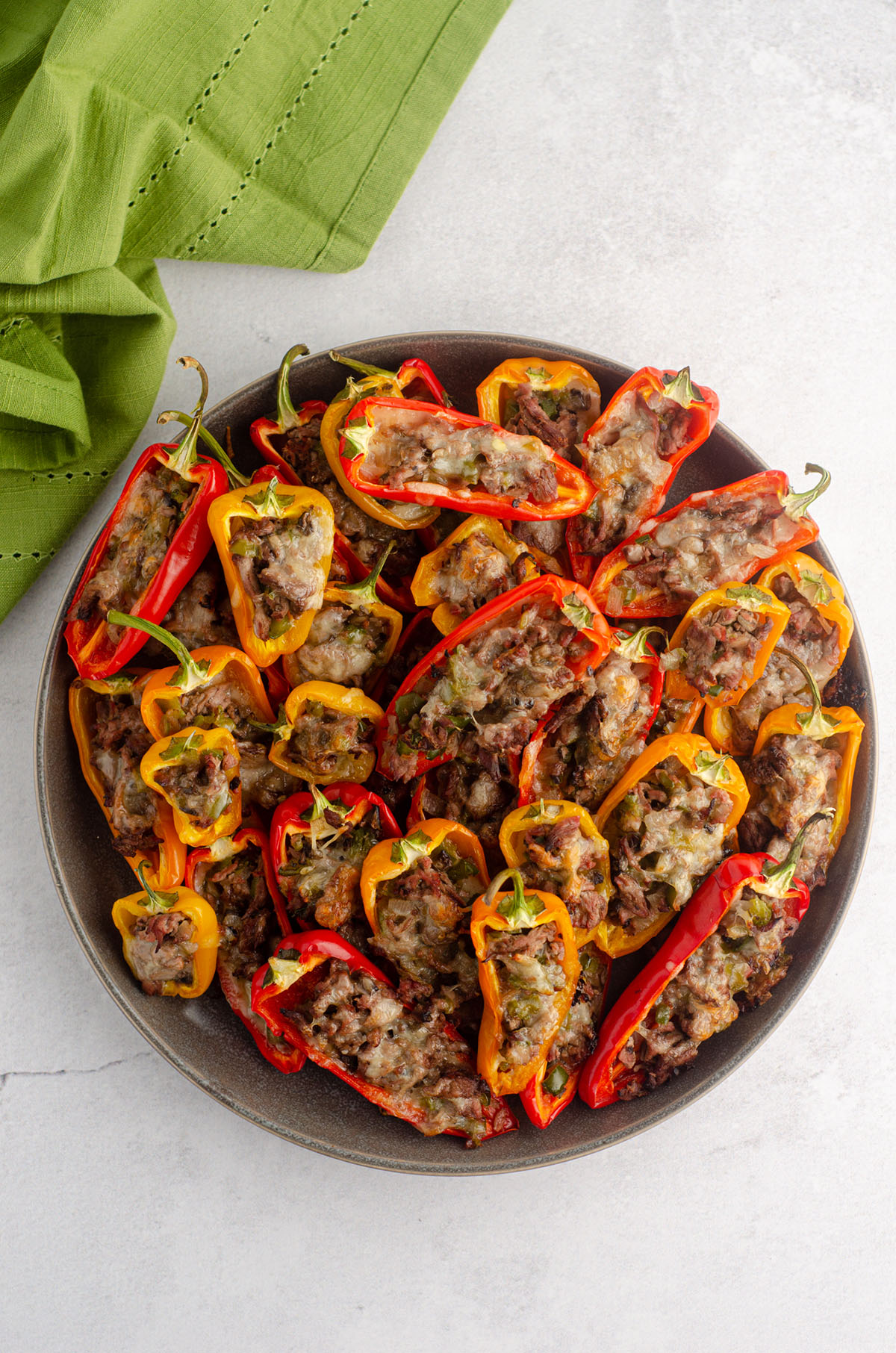 aerial photo of a plate of mini philly cheesesteak stuffed peppers