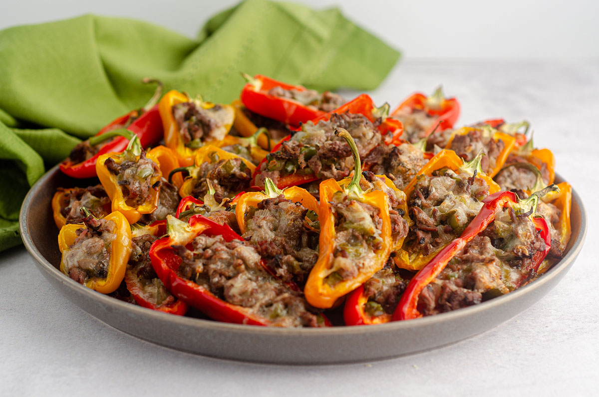 platter of mini philly cheesesteak stuffed peppers