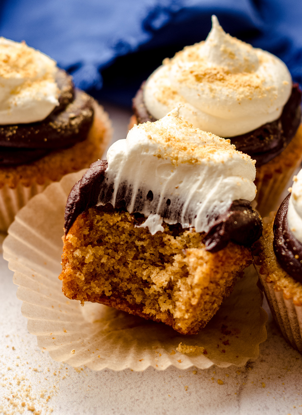 s'mores cupcake with a bite taken out of it