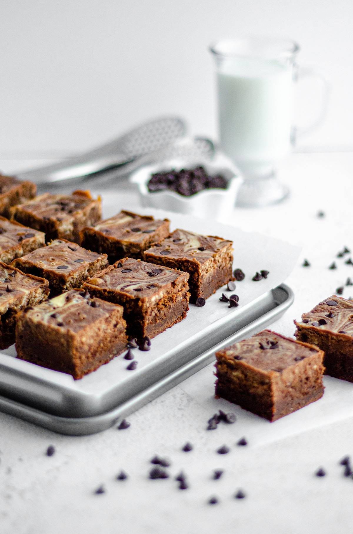 Chocolate Chip Cheesecake Swirl Brownies: Dense and fudgy scratch brownies swirled with sweet chocolate chip cheesecake.