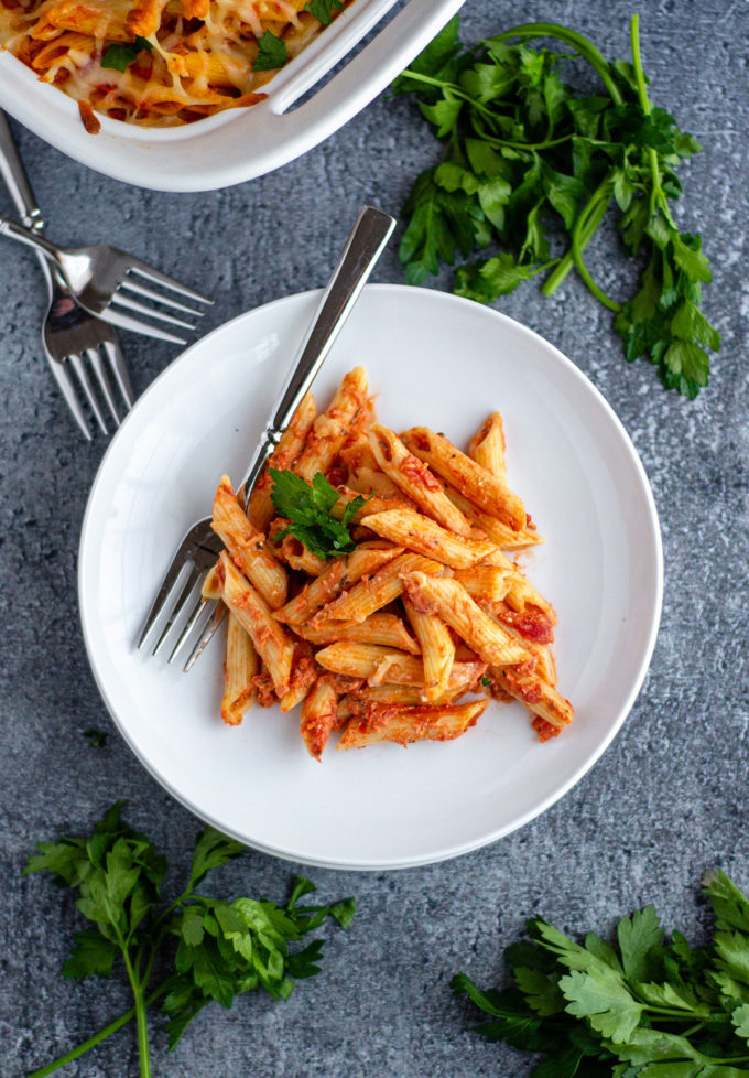 aerial shot of baked ziti on a plate with a fork