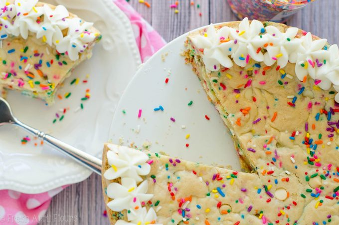 Funfetti Sugar Cookie Cake: Soft and buttery in the center, crunchy around the edges, and filled with plenty of white chocolate chips and sprinkles to celebrate any occasion. Topped with a creamy and buttery almond vanilla buttercream.