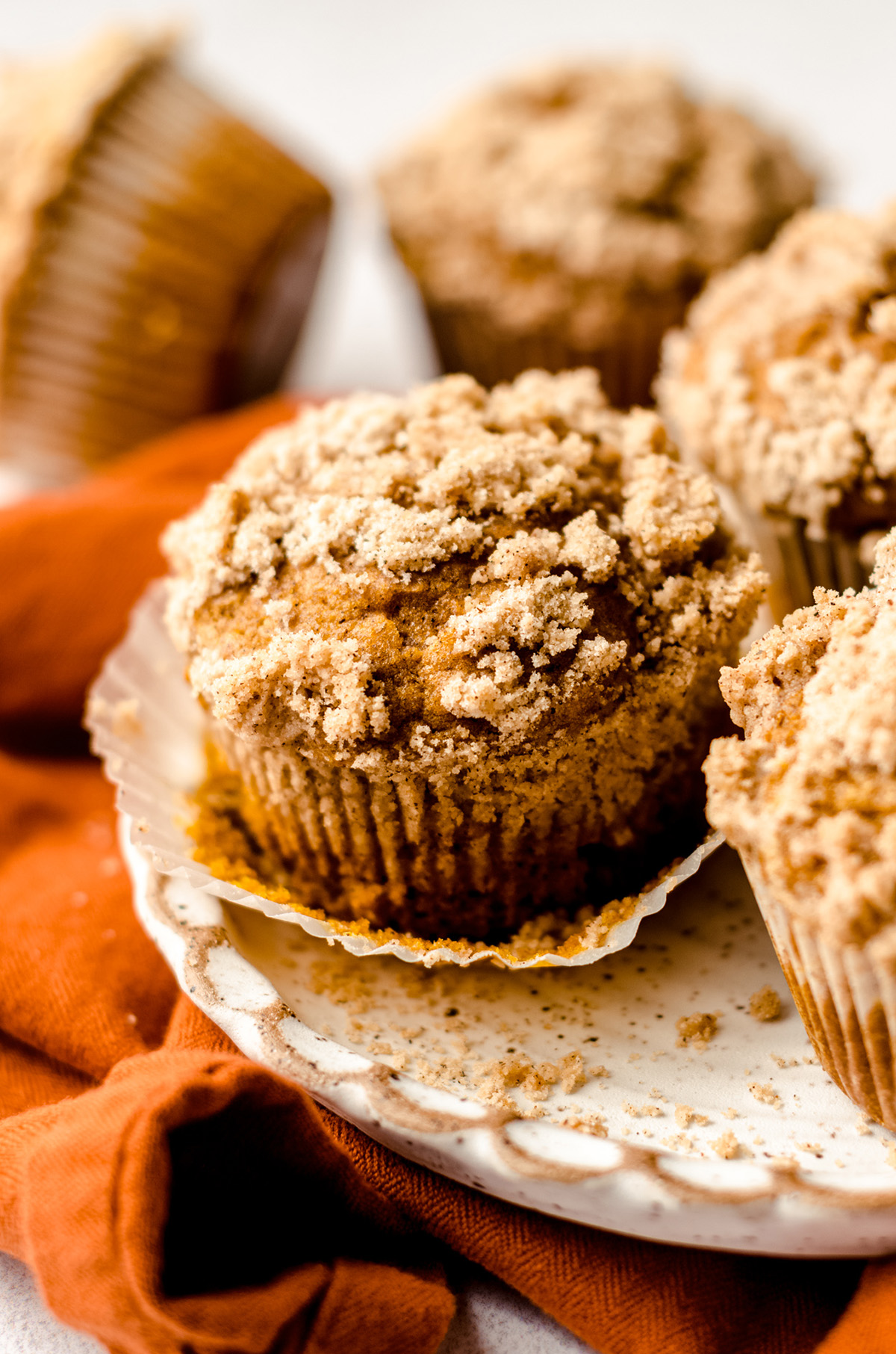 unwrapped pumpkin muffin on a plate