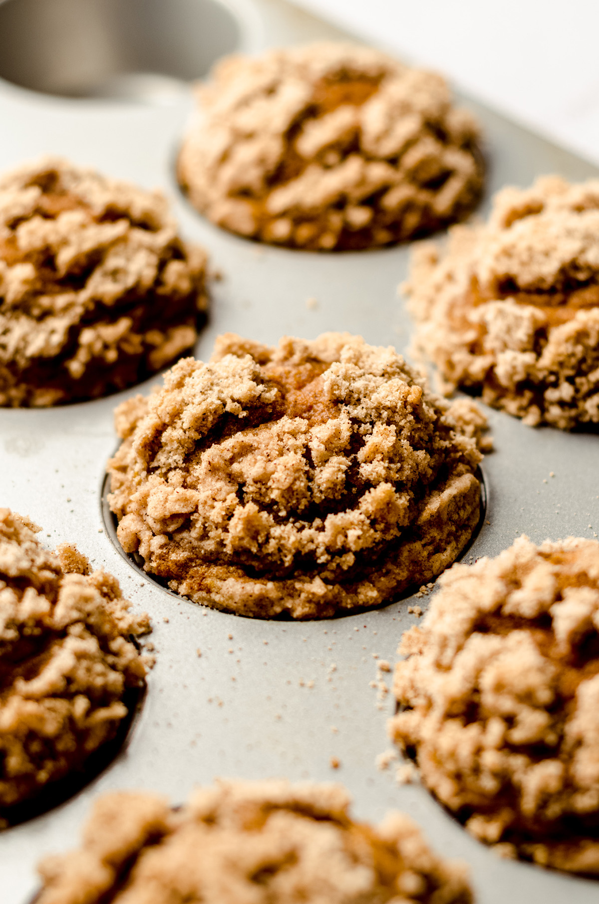 pumpkin streusel muffins in a muffin pan