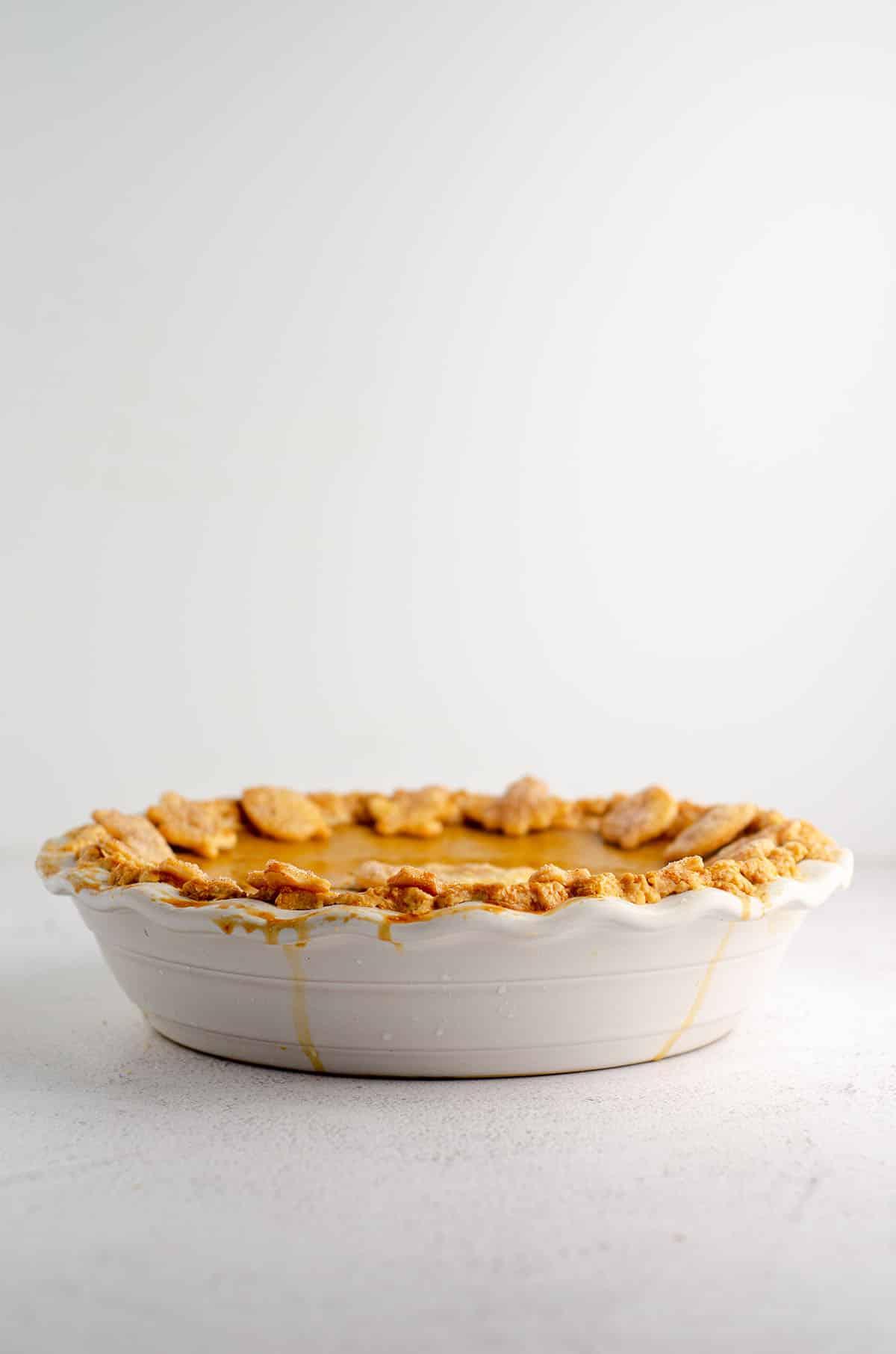 pumpkin pie in a white pie dish