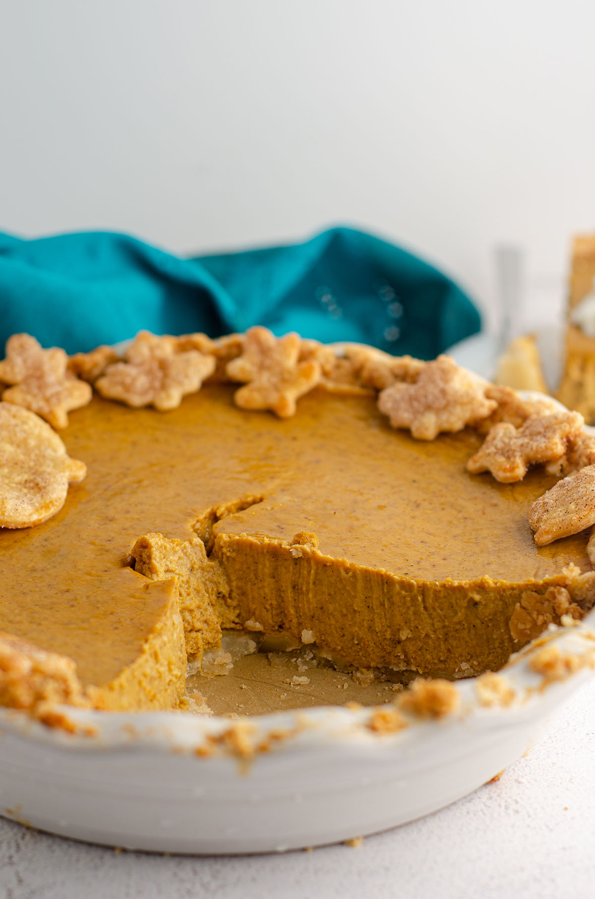 pumpkin pie with some slices removed