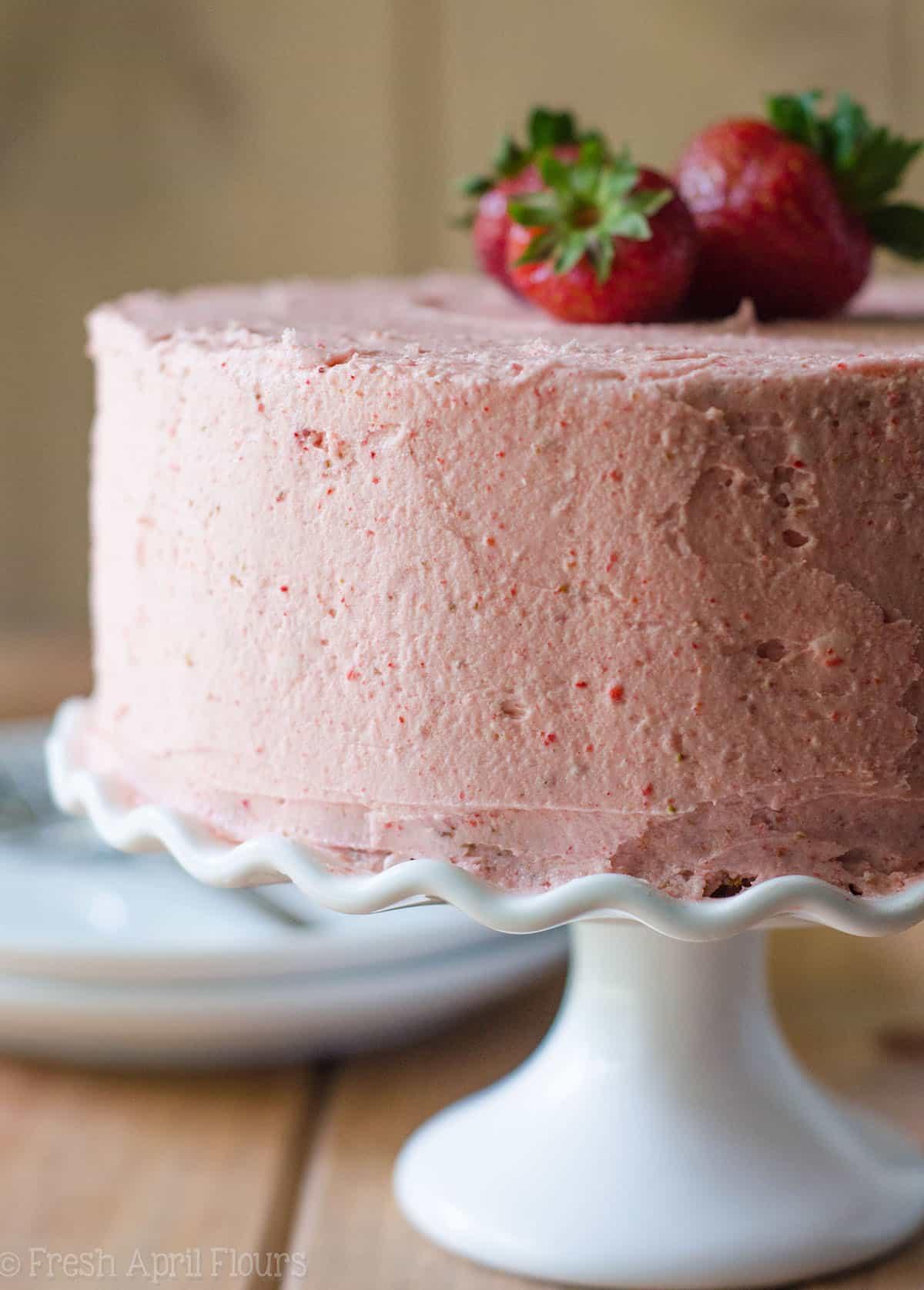 fresh strawberry cake on a cake stand