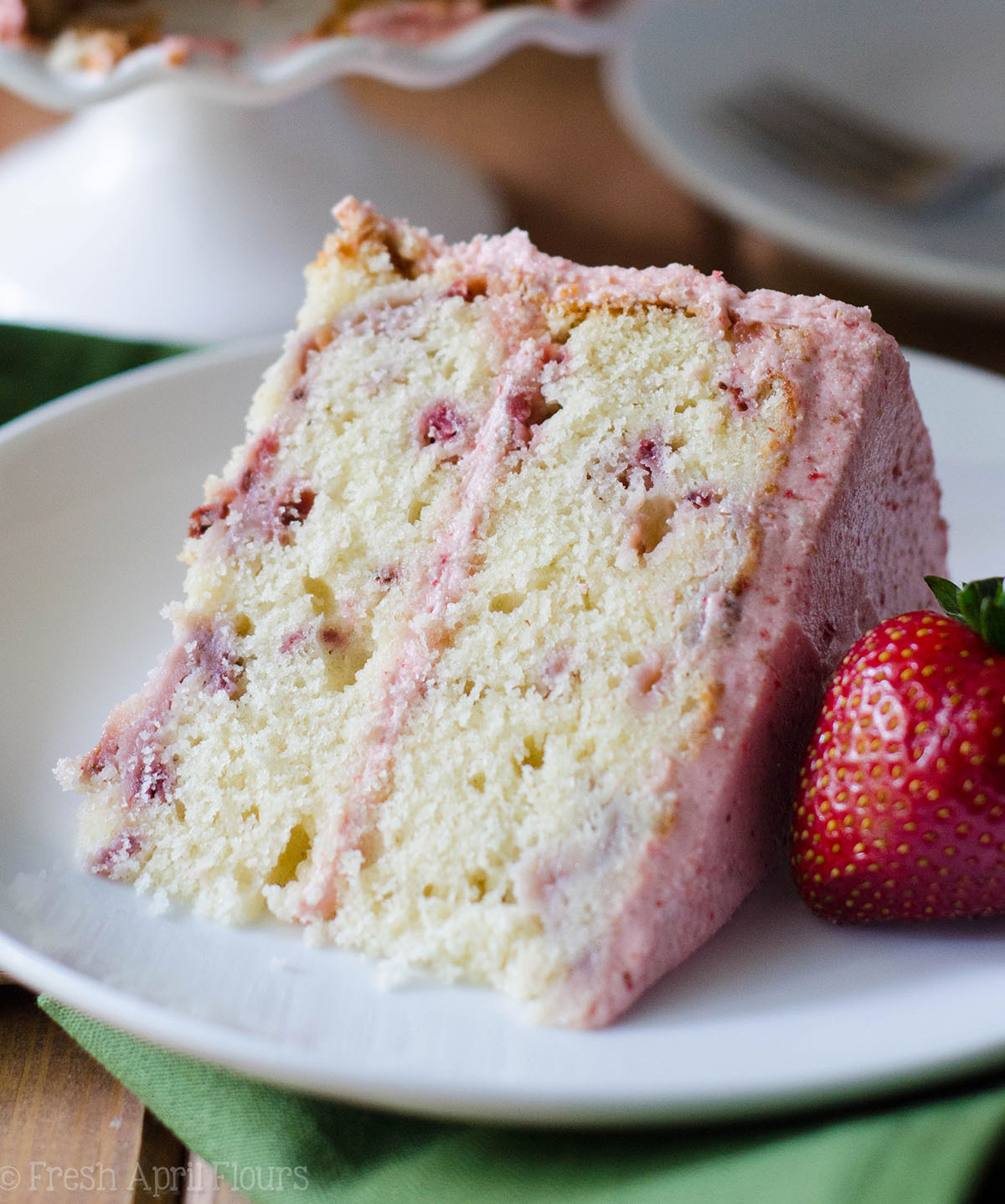 slice of fresh strawberry cake on a plate