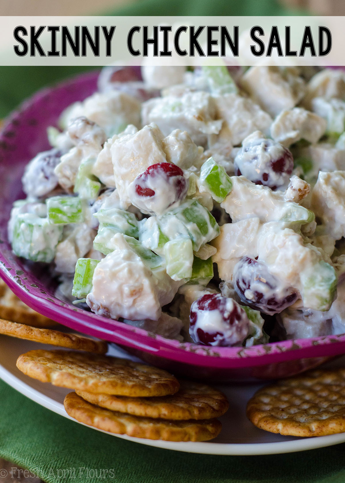 "Traditionally calorie-laden chicken salad gets a healthy upgrade using Greek yogurt and spices. Celery, grapes, and walnuts add the perfect crunch and flavors to insure you won't miss the ""real"" thing!"