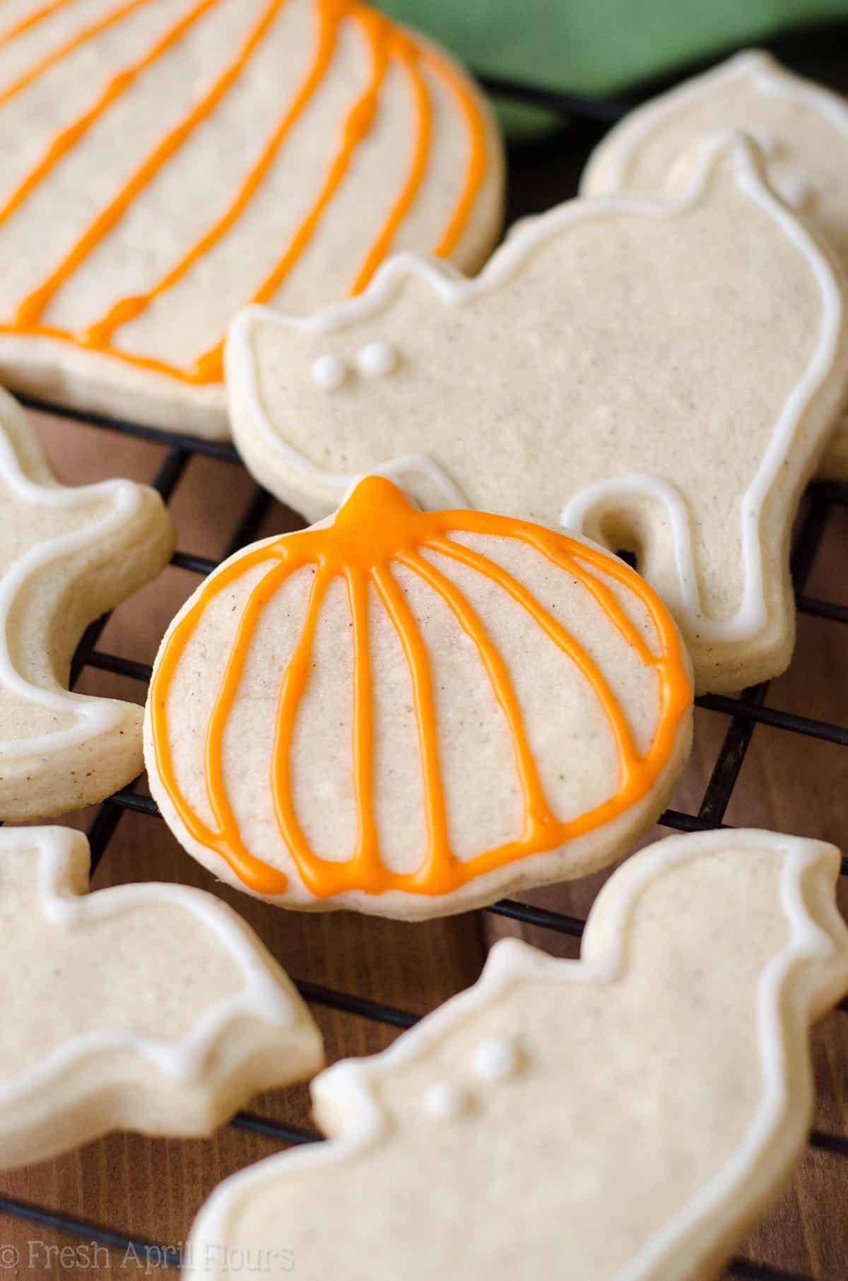 pumpkin spice sugar cookies on a cooling rack