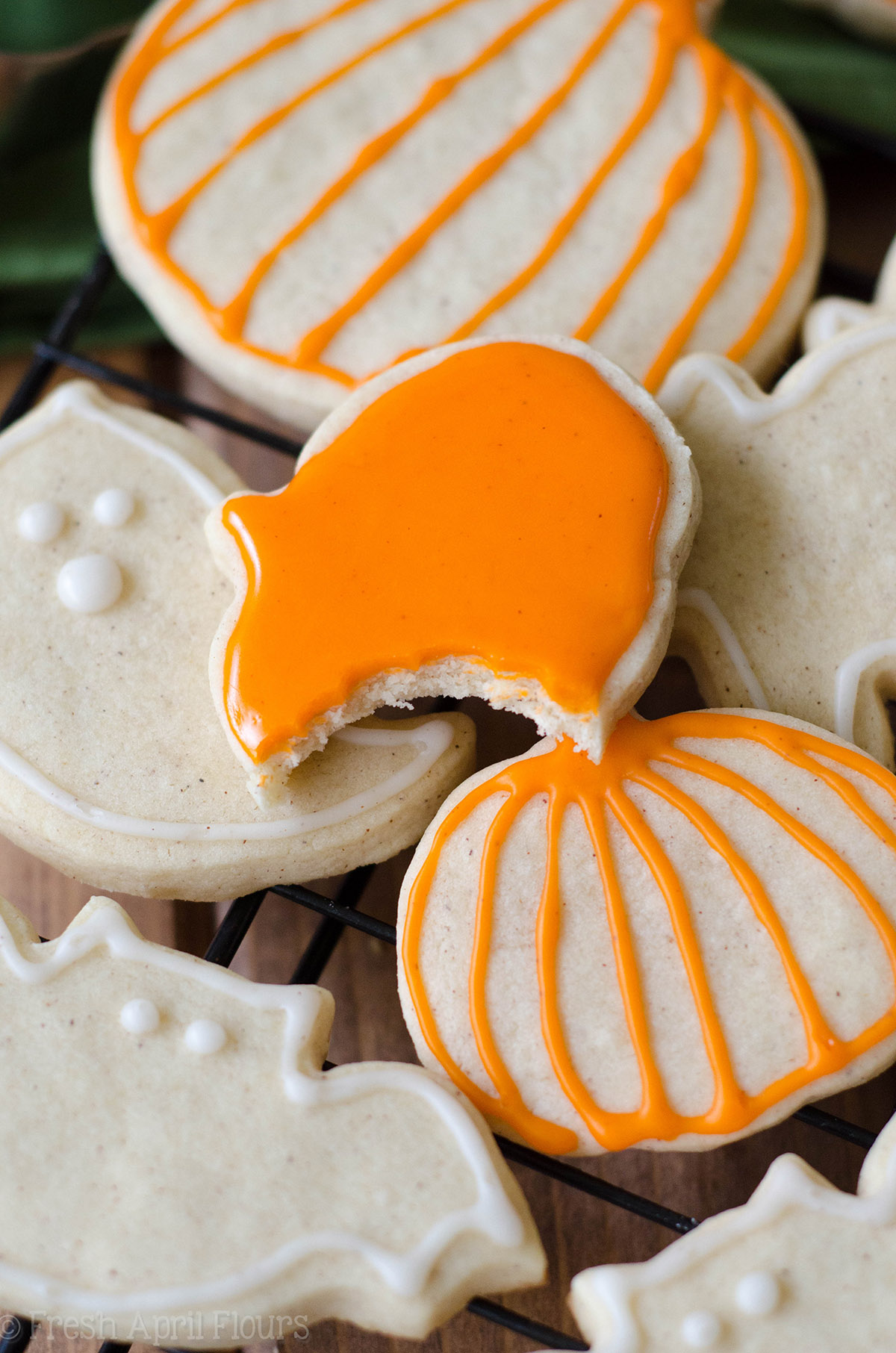 pumpkin spice sugar cookie with a bite taken out of it