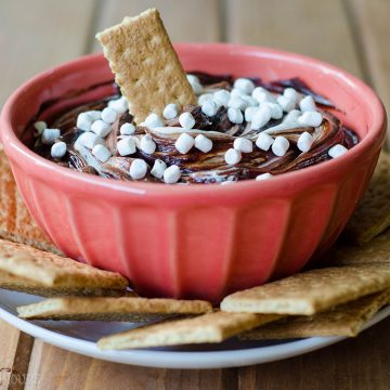 S'mores Dip: An easy gluten free dip made with marshmallow buttercream swirled with chocolate ganache. Serve with graham crackers or your favorite crunchy dipper and have the taste of summer all year long!