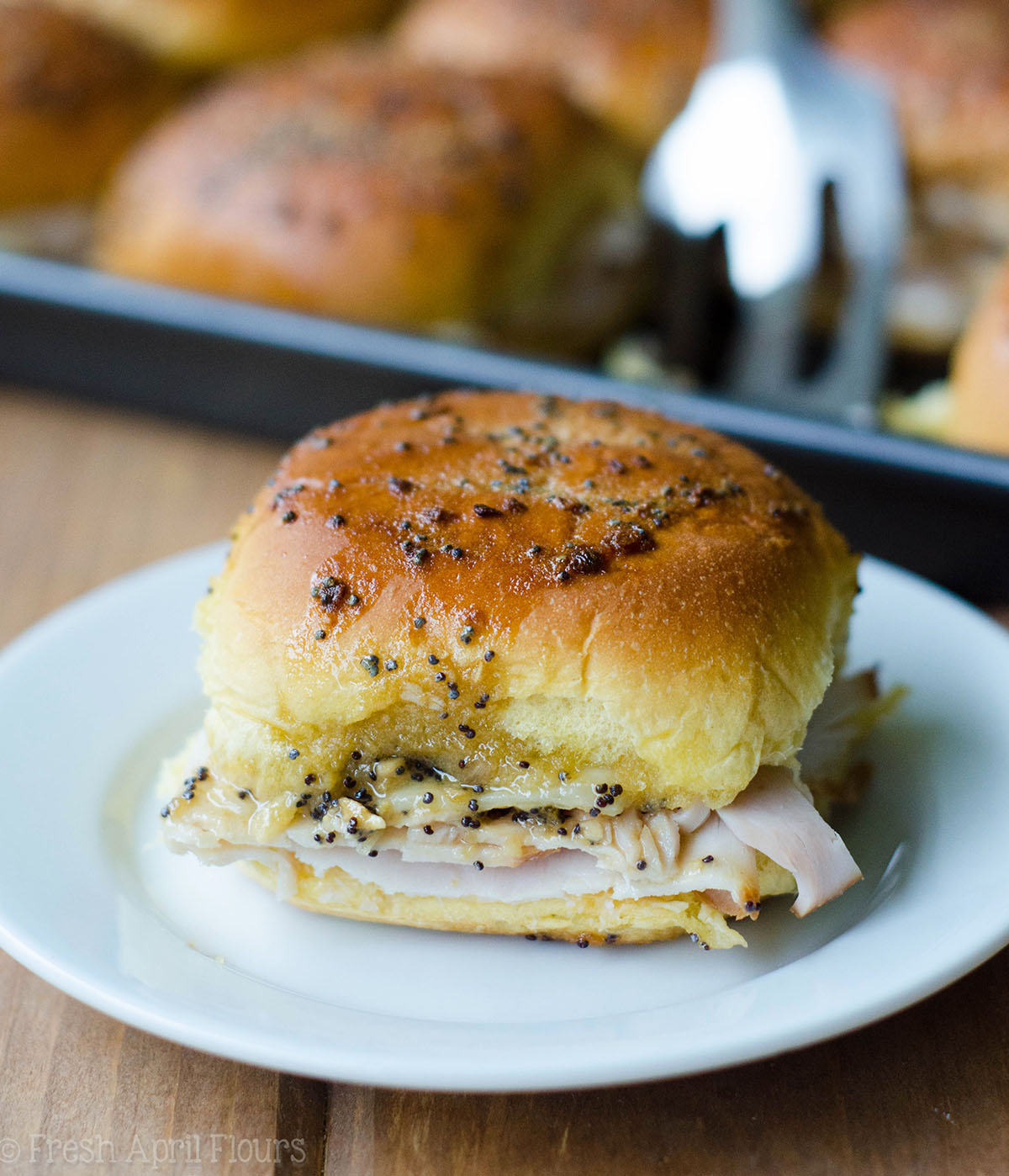 baked turkey and cheese slider on a plate
