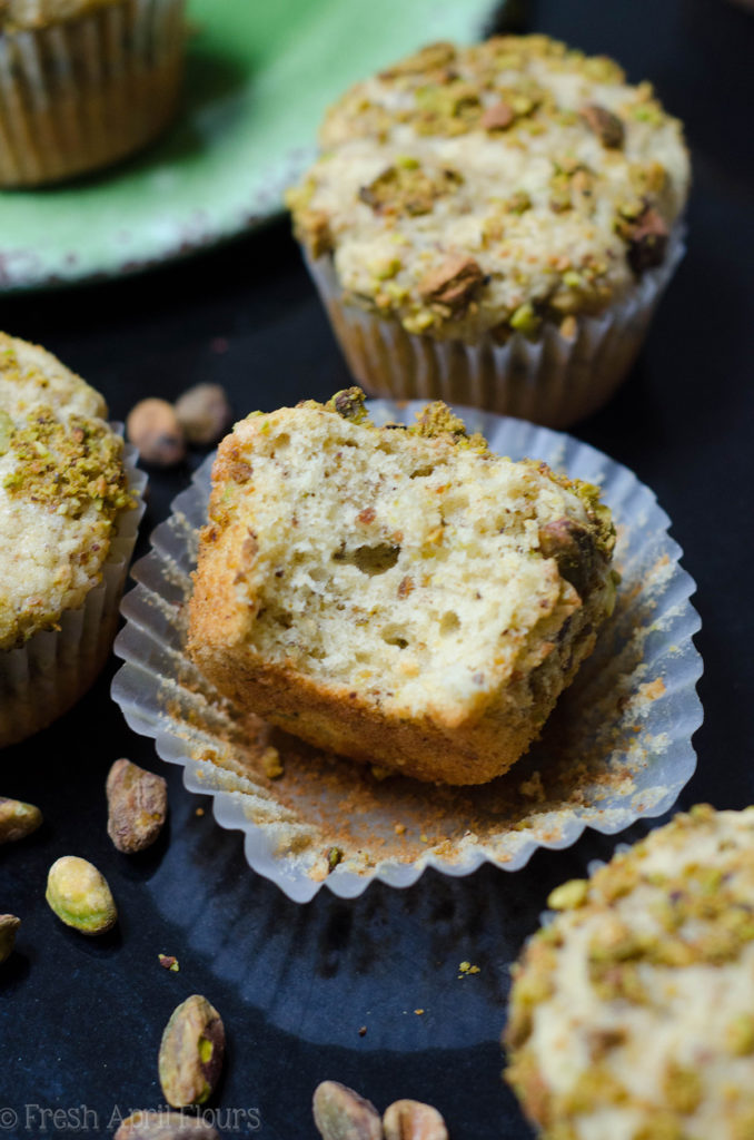 pistachio muffin with a bite taken out of it