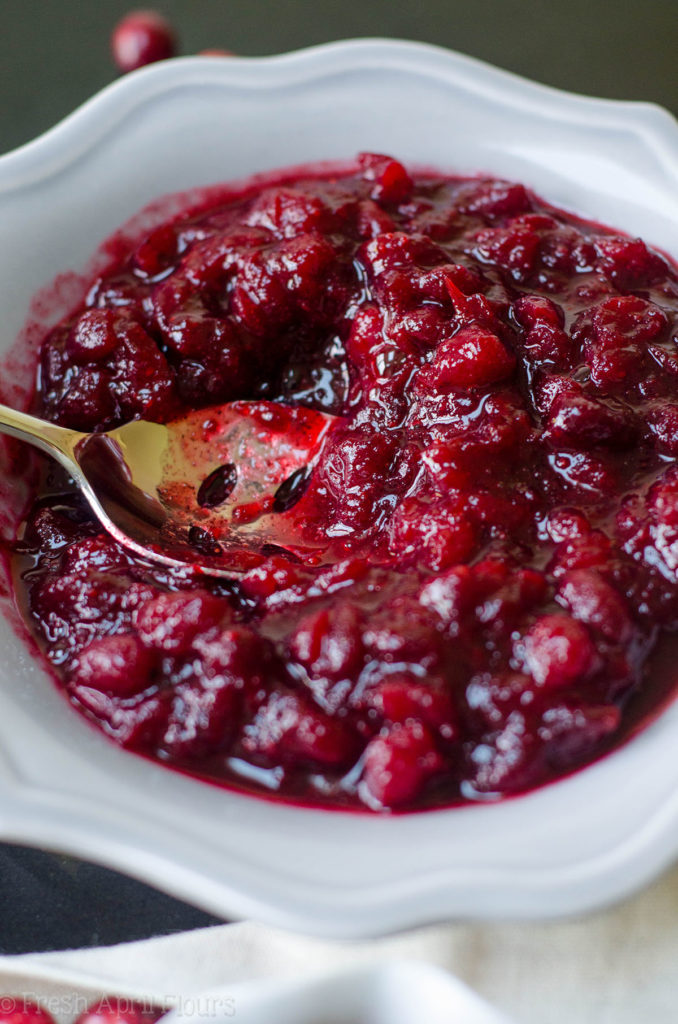 Homemade Spiced Cranberry Sauce: Traditional cranberry sauce gets a spicy makeover to keep Thanksgiving interesting! Spiced with cinnamon and cloves, this cranberry sauce will add a little flair to your holiday spread.