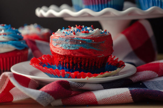 Red, White, & Blue Swirl Cupcakes: Beautifully swirled cupcakes that taste as great as they look! Perfect for any patriotic celebration or any time you want some American pride in your dessert.