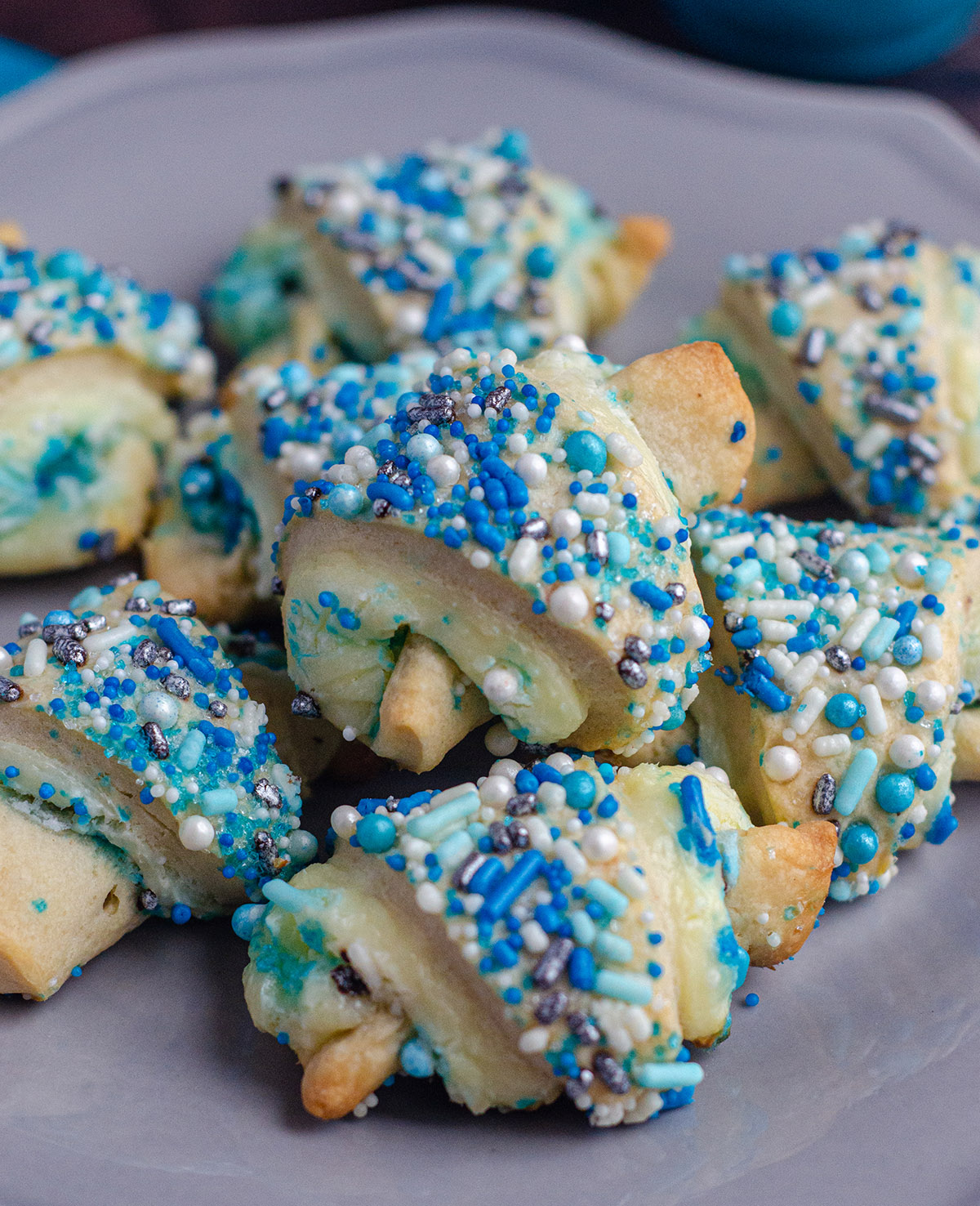 Basic rugelach filled with a sweetened cream cheese filling and plenty of sprinkles inside and out.