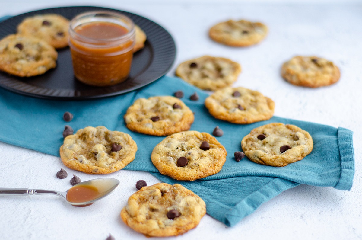 salted caramel chocolate chip cookies on a kitchen towel