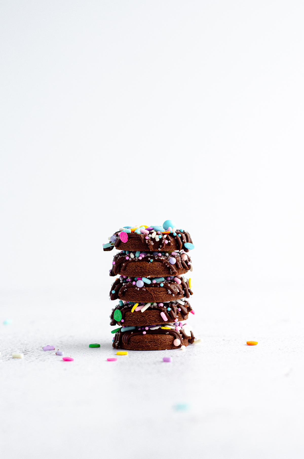 stack of decorated chocolate cut-out sugar cookies