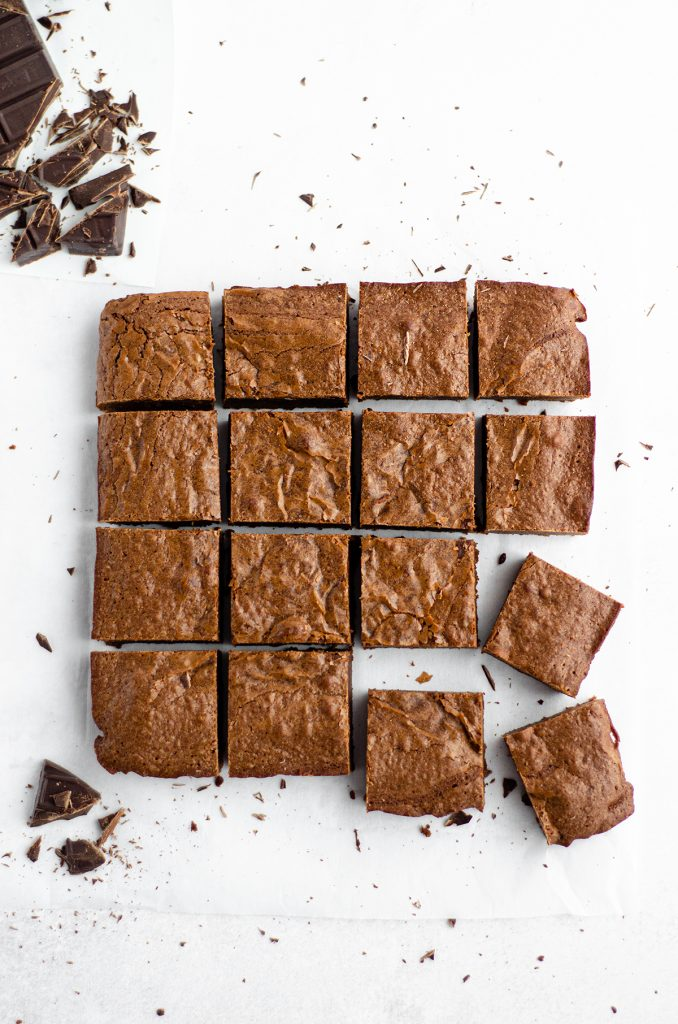 aerial photo of homemade fudgy brownies cut into squares