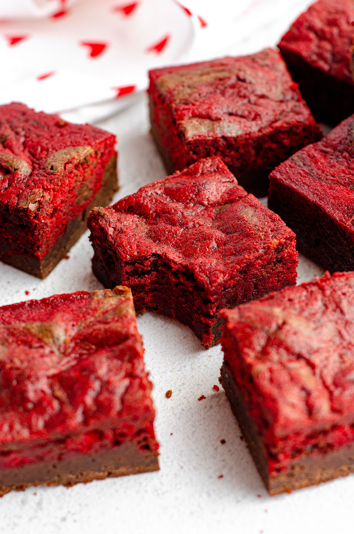 red velvet brownie with a bite taken out of it