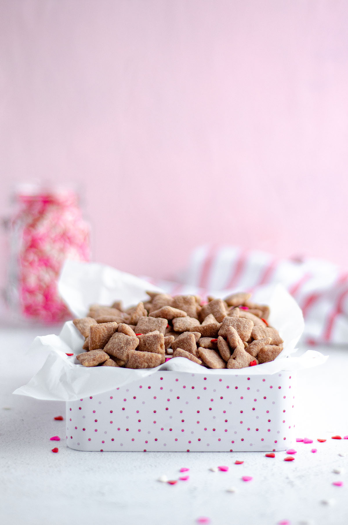 Classic puppy chow cereal snack mix gets a red velvet makeover, flavored with white chocolate and red velvet cake mix.