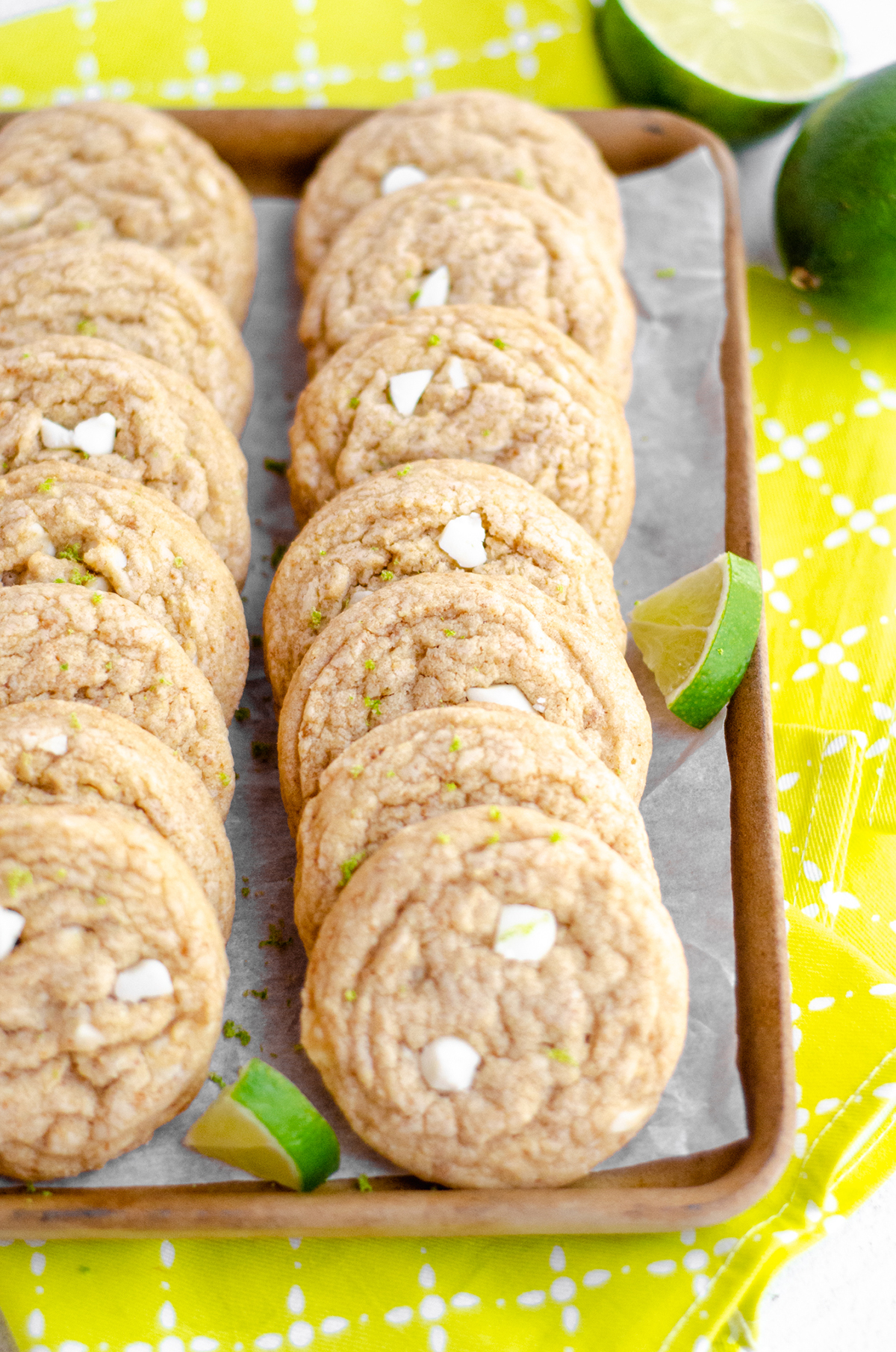 key lime cookies in a serving platter with slices of lime scattered around